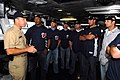 US Navy 070501-N-3659B-179 USS Ronald Reagan (CVN 76) Commanding Officer, Capt. Terry B. Kraft, explains bridge operations to representatives of the Washington Nationals baseball team.jpg