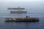US Navy 070522-N-8157C-240 (from foreground) USS Nimitz (CVN 68), USS Bonhomme Richard (LHD 6) and USS John C. Stennis (CVN 74) transit the Gulf of Oman