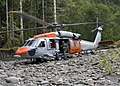 US Navy 070820-N-8029B-028 A search and rescue (SAR) crew from Naval Air Station Whidbey Island perform Confined Area Landings in the foothills of the Olympic Mountains.jpg