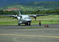 US Navy 070901-N-1713L-047 A Panamanian airman guides a Colombian CN-235 aircraft onto the tarmac at Tocumen International Airport as part of the Combined Forces Air Combatant Command during PANAMAX 2007.jpg