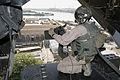 US Navy 071110-M-7404B-057 U.S. Marine Sgt. Danny L. Herrman, a flight line crew chief with Marine Medium Tiltrotor Squadron-263, mans a 240 Gulf heavy machine gun.jpg