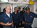 US Navy 080911-N-8688D-003 Chief Engineman Charlie Armstrong shows Vice Adm. D.C. Curtis, commander, Naval Surface Forces, the central control station aboard the amphibious dock landing ship USS Rushmore (LSD 47).jpg