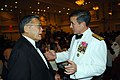 US Navy 090417-N-9268E-068 Vice Adm. Harry B. Harris Jr., Deputy Chief of Naval Operations for Communication Networks, speaks with former Secretary of Transportation Norman Y. Mineta.jpg