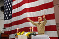 US Navy 090419-N-2344B-175 Cmdr. Lee Axtell delivers the benediction at a protestant service in the hangar bay aboard the aircraft carrier USS Ronald Reagan (CVN 76).jpg