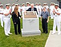 US Navy 090709-N-8848T-438 Daniel Murphy touches a plaque dedicated to his son, U.S. Navy Lt. Michael P. Murphy.jpg