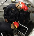 US Navy 091023-N-7498L-118 Chief Damage Controlman Gregory Hightower oversees the closure of a flooded hatch during a training demonstration on the $2.5 million Surface Damage Control Trainer at the Center of Naval Engineering.jpg