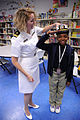 US Navy 091029-N-6220J-006 Lt. j.g. Meg Ferguson teaches a young girl the proper way to salute during a U.S. Navy community service event at the Finnigan Park Boys and Girls Club.jpg