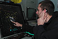 US Navy 091101-N-8960W-009 Air Traffic Controller 3rd Class Elliott Young, assigned to the aircraft carrier USS Nimitz (CVN 68), performs a traffic call to departing aircraft.jpg