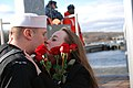US Navy 091201-N-4437G-061 Sonar Technician 3rd Class Tad Hatch kisses his wife during a homecoming celebration for the Los Angeles-class attack submarine USS San Juan (SSN 751).jpg