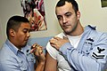 US Navy 091214-N-1251W-016 Hospital Corpsman 2nd Class Eric Pacheco administers the H1N1 flu vaccine to Interior Communications Electrician 2nd Class Stuart Ringrose.jpg
