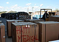 US Navy 100121-N-8241M-007 A Sailor moves pallets of relief supplies at the airfield at Naval Station Guantanamo Bay.jpg