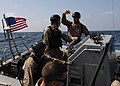 US Navy 100201-N-7088A-085 Sailors discusses boarding tactics.jpg