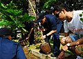 US Navy 100216-N-2218S-013 Sailors assigned to the guided-missile cruiser USS Shiloh (CG 67) and members of the local volunteer group Spirit to Serve, plant trees at a school during a community service project in Pattai, Thaila.jpg