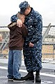 US Navy 110321-N-KB563-274 Information Systems Technician 1st Class Justin Reed tells his son goodbye aboard the amphibious transport dock ship USS.jpg