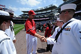 US Navy 110515-N-AD372-105 Washington Nationals pitcher Cole Kimball takes a moment to congratulate the 2010 Sailors of the Year before being honor.jpg