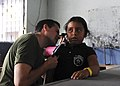 US Navy 110630-F-ET173-099 Peruvian navy Cmdr. Mauricio Adrian checks a patient's ears at the Los Angeles surgical screening site.jpg