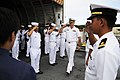 US Navy 110727-N-WP746-530 Capt. William C. Johnson, commanding officer of the guided-missile cruiser USS Lake Erie (CG 70), comes aboard the Phili.jpg