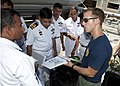 US Navy 110910-N-HA376-143 Navy Diver 2nd Class Ryan Fitzgerall, assigned to Mobile Diving and Salvage Unit (MDSU) 1, shows divers from the Banglad.jpg