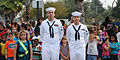 US Navy 111007-N-GO855-014 Logistics Specialist 2nd Class Robert Bello and Yeoman 2nd Class Michael Corrales await the commencement of the ceremony.jpg