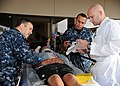 US Navy 111117-N-UB993-060 Staff reviewS patient information and injuries during drill..jpg