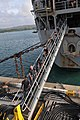 US Navy 111214-N-WG146-093 Sailors assigned to the deck department aboard the submarine tender USS Emory S. Land (AS 39) haul shore power cables af.jpg