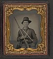 Unidentified young soldier in Union uniform and Hardee hat sitting with musket, cartridge box, and cap box LOC 5229163760.jpg