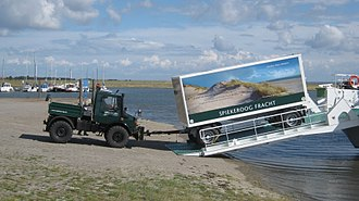 Tractor unit - Unimog U1400 4×4 truck pulling a trailer from a RoRo ferry ship