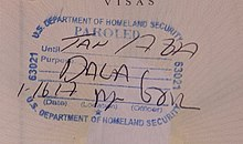 A stamp applied to the Mexican passport of a DACA recipient entering the United States with Advance Parole at John F. Kennedy International Airport in January 2017, with handwritten annotations indicating the passport holder was paroled into the United States.