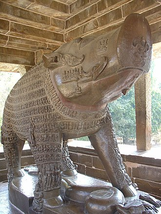 Varaha - Zoomorphic Varaha, Khajuraho. On its body are carved saints, sages, gods, seven mothers and numerous beings which he symbolically protects. The goddess earth is ruined and missing.
