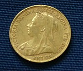 A gold coin, with the portrait of a veiled woman on it