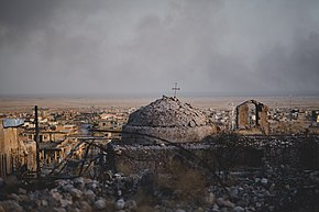 Views in June of 2019 of a cathedral rising above ruined buildings in the old neighborhood of Shingal (Sinjar) 18.jpg