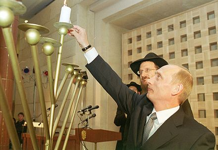 President Putin lighting a Hannukah Menorah with Russia's Chief Rabbi Berel Lazar. Judaism is officially designated as one of Russia's four state-religions.[106]