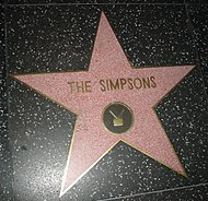 The Simpsons have been awarded a star on the Hollywood Walk of Fame.