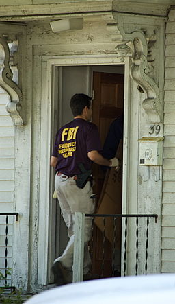 Watertown FBI raid - agent entering house