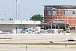 Whimbrel (foreground left), Gerald R. Ford Int'l airport, June 14, 2012 (7372152934).jpg