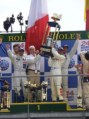 2009 24 Hours of Le Mans - Winning drivers of 24 Hours Le Mans on the podium, 14 June 2009
