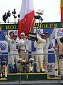 Winning drivers of 24 Hours Le Mans on the podium, 14 June 2009.jpg