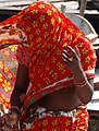 Woman Dressing in Sari - Magh Mela Festival Sangam Site - Allahabad - Uttar Pradesh - India (12589169053).jpg