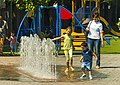 Woman with children playing in fountain on Como lakefront.jpg
