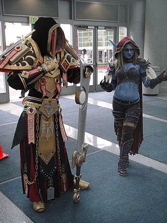 Paladin (character class) - A cosplayer dressed as a Tier 2 Warcraft paladin (left).