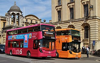 Oxford Bus Company - Route-branded Wright StreetDeck buses outside The Queen's College, Oxford in 2017