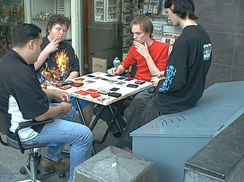 Kids playing Yu-Gi-Oh!