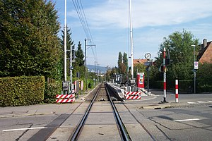 Zürich Schweighof railway station - The station, looking downhill to the station's single track and platform