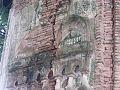 ঢোলহাট মন্দিরের দেয়ালের বাইরের অংশে কারুকার্য ধসে পড়ছে ও আগাছায় পতিত 01.jpg