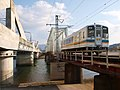 川内川にかかる九州新幹線と肥薩おれんじ鉄道の鉄橋 Old and New Railroad Bridge - panoramio.jpg
