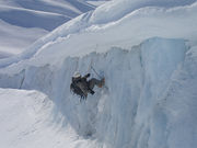 10th Special Forces Group (Airborne) Mountaineer climbs out of Worthington Glacier during the US Army SF Master Mountaineer course