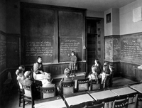 1893 Horace Mann School for the Deaf, Miss Fuller and Her Class byAHFolsom BostonPublicLibrary.png