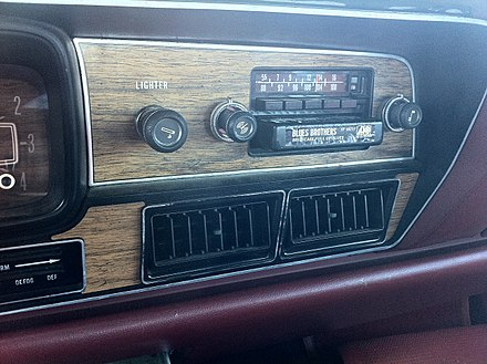 "Factory installed AM/FM radio/8-track unit in a 1978 AMC Matador with a Briefcase Full of Blues cartridge in ""play"" position 1978 AMC Matador sedan red NC detail of factory AM-FM-stereo-8-track unit.jpg"