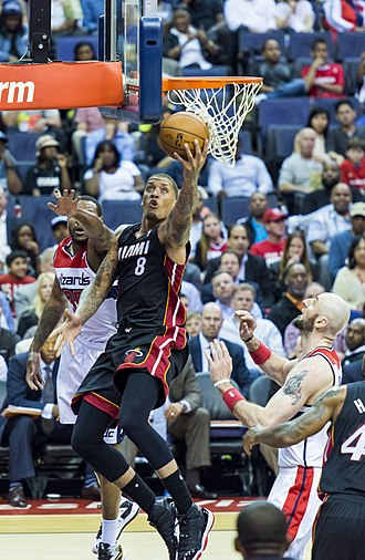 Michael Beasley - Beasley during his second tenure with the Heat, playing against the Washington Wizards in April 2014.