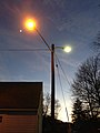 2014-12-26 17 05 23 Sodium vapor and mercury vapor street lights just after turning on for the night on the same utility pole along an alley adjacent to Winthrop Avenue in Ewing, New Jersey.JPG